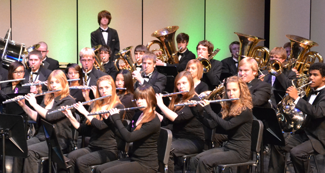 photo of band students performing on stage.