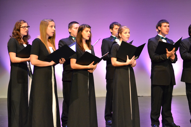 photo of choir students performing on stage.