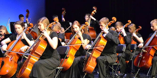 photo of orchestra students performing on stage.