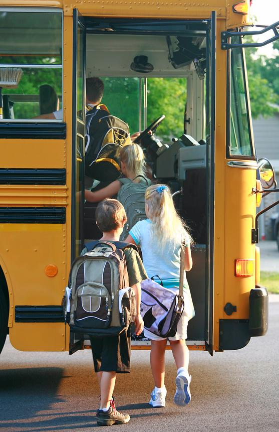 Students loading a school bus.